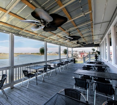 topsail island dining deck | Coastline Realty Vacations