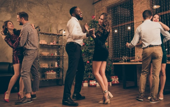 couple dancing at new years eve party | Coastline Realty