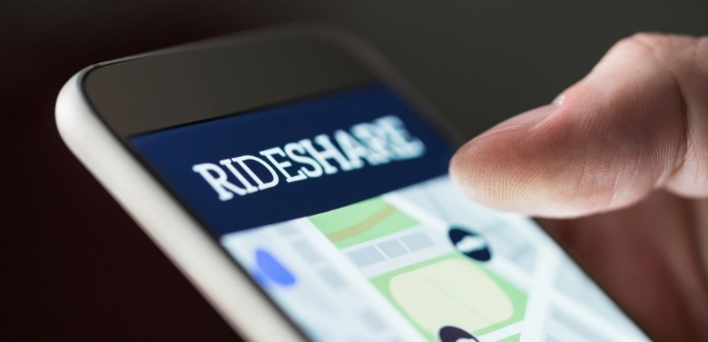 person requesting ride share services on phone | Coastline Realty