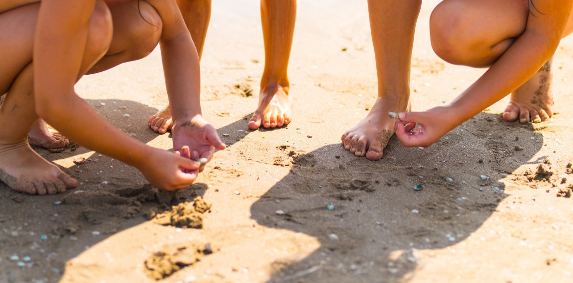 children hunting for seashells at the beach | Coastline Realty Vacations