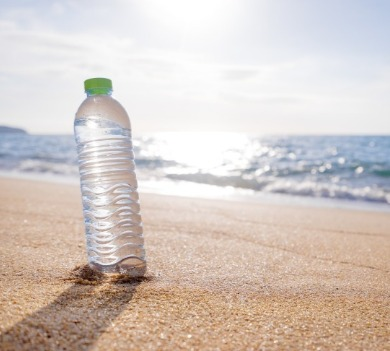 water bottle on beach | Coastline Realty Vacations