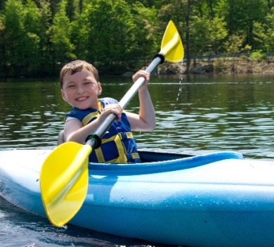 child kayaking in topsail, nc | Coastline Realty Vacations