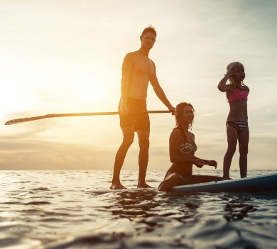 paddleboarding  on topsail beach | Coastline Realty Vacations