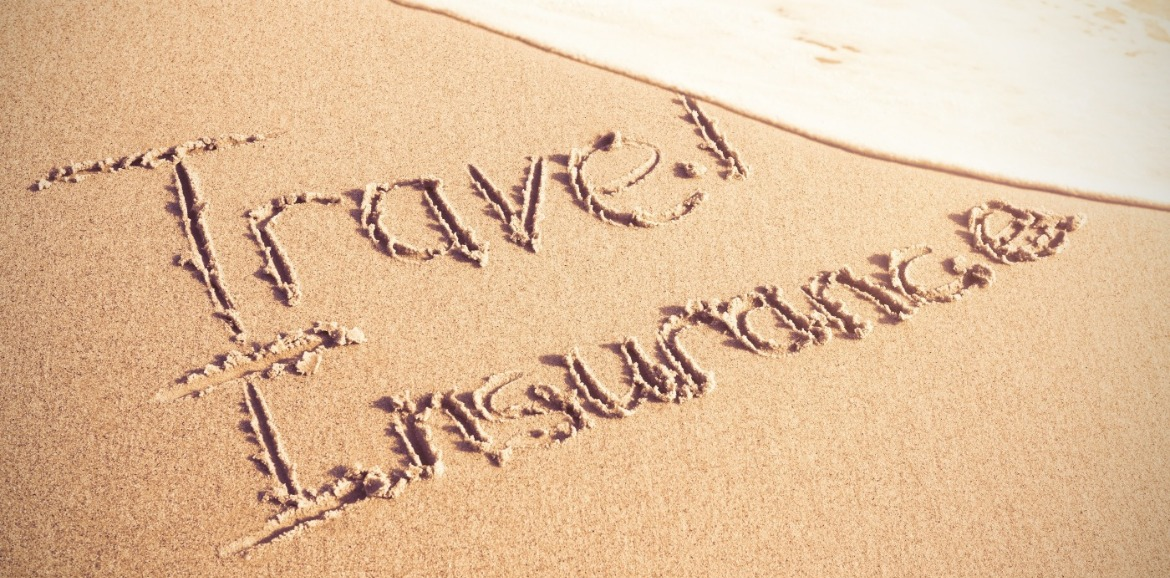 travel insurance written in sand | Coastline Realty Vacations