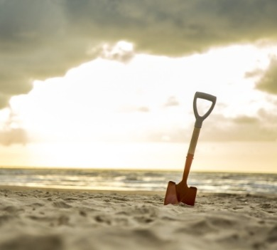 small shovel on the beach | Coastline Realty