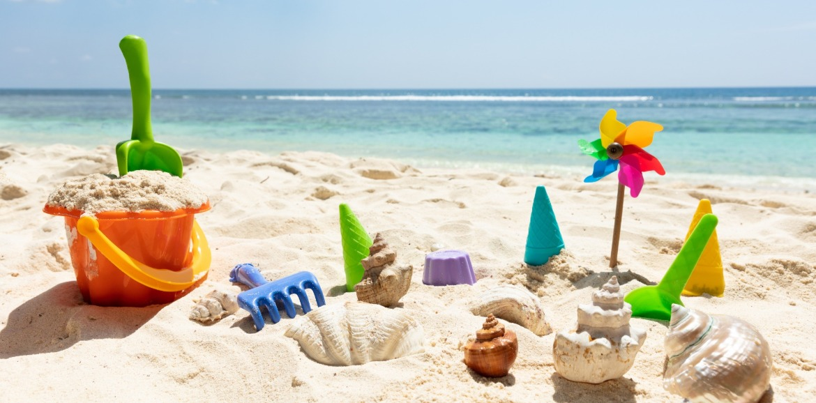 beach toys on the beach | Coastline Realty