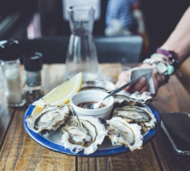 seafood on a blue plate | Coastline Realty Vacations