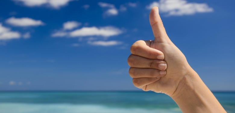 thumbs up on beach | Coastline Realty Vacations